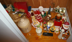 Assorted Holiday Decorations On Closet Floor