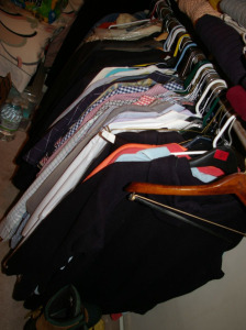 Assorted Men's Clothing: Shirts, Sports Jackets on Lower Rack
