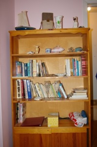 Contents of Bookcase - Books, Figurines,