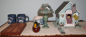 Contents: Top of Chest Bird House, Small Decoy, Coffee Mugs